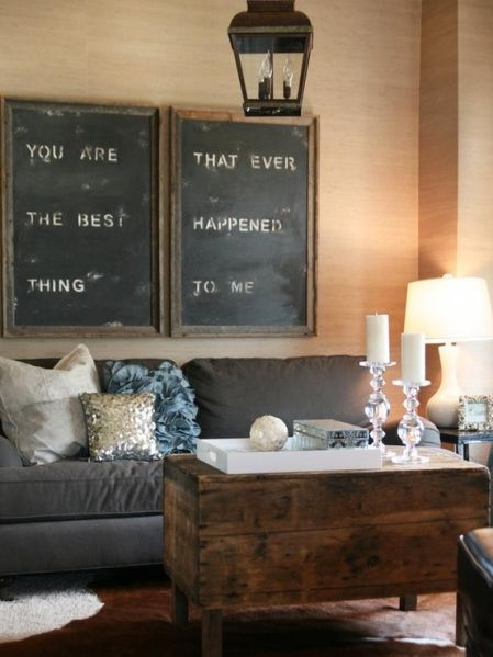 Rustic Living Room: chalkboard wall art, vintage lighting fixture, wooden coffee table, cool tones, contemporary touches.