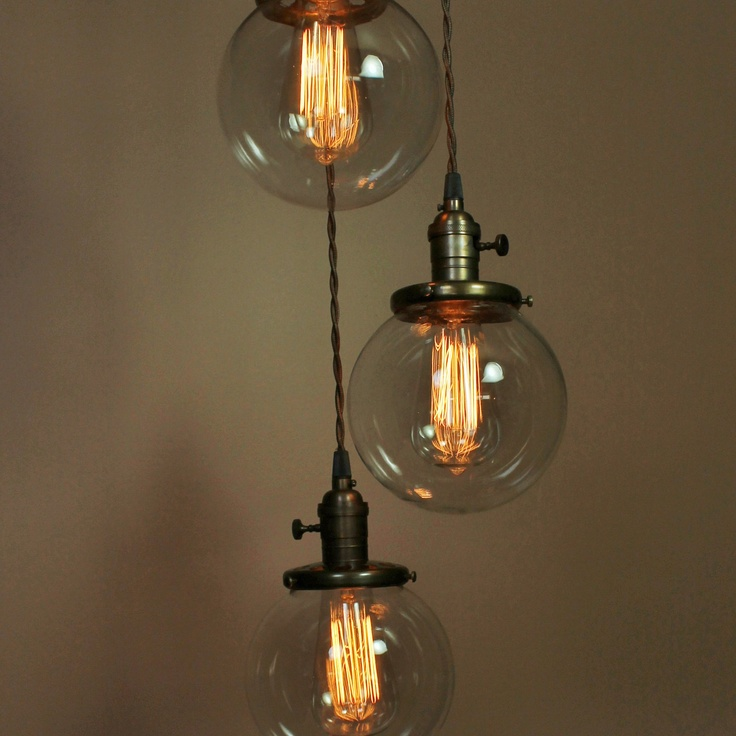 Or something like this...  3 Light Chandelier - Cascading Pendant Lights - with 6 inch Clear Glass Globes, Exposed Socket Design and Edison Light Bulbs. $289.00, via Etsy.