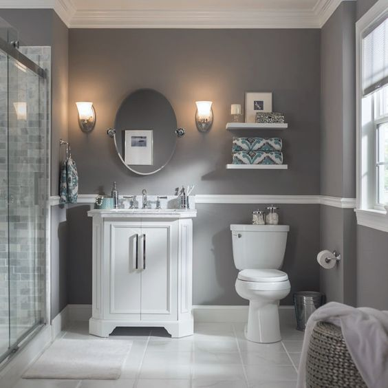 A pair of wall sconces perfectly frame this bathroom mirror. Select vanity lights based on the size of your bathroom and the amount of light needed.: