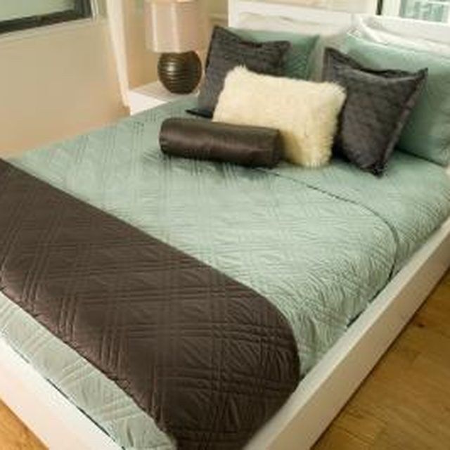 A simple platform bed accentuates a modern bedroom decor.