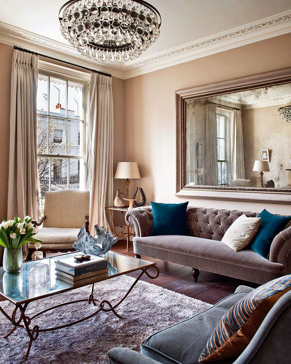 I love contemporary interiors, but this classically styled interior is so good to look at... something about the ultra blue cushions set against a dusky mauve sofa.