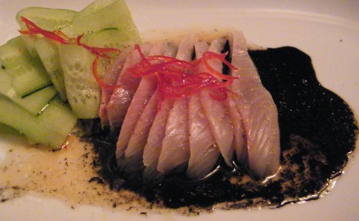 Kingfish crudo w squid ink, cucumber & chilli