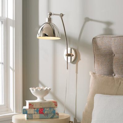 Swing arm wall lamps can be the perfect lighting solution when tabletop space is not available beside beds behind sofas between bookshelves