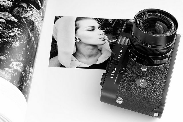 Leica M4-P with Elmarit 28mm, laying on a book with photographs of Jeanloup Sieff.