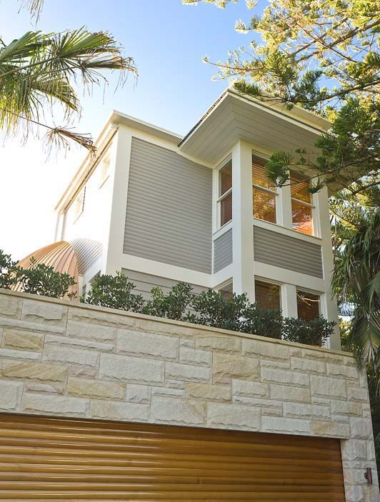Palm Beach Tower House « WALTER BARDA DESIGN. Sandstone garage with natural timber look electric door, the main building in grey weatherboard with white trimmings/shutters/louvre windows. LOVE IT.