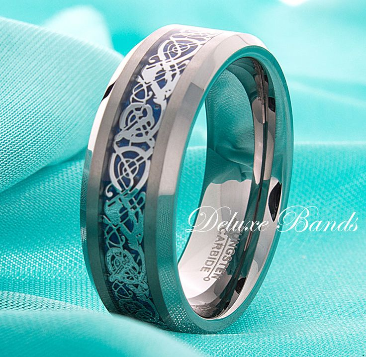 Celtic Dragon Tungsten Band Blue Celtic Dragon Tungsten Ring Mens Wedding Ring 8mm Beveled Edges Irish Promise Ring His Hers FREE Engraving by DeluxeBands on Etsy https://www.etsy.com/listing/212225281/celtic-dragon-tungsten-band-blue-celtic