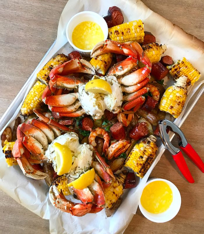 An easy way to put together a crab boil with no mess and no fuss. Start with cooked crab from your local seafood market + add these fixin's to go with.