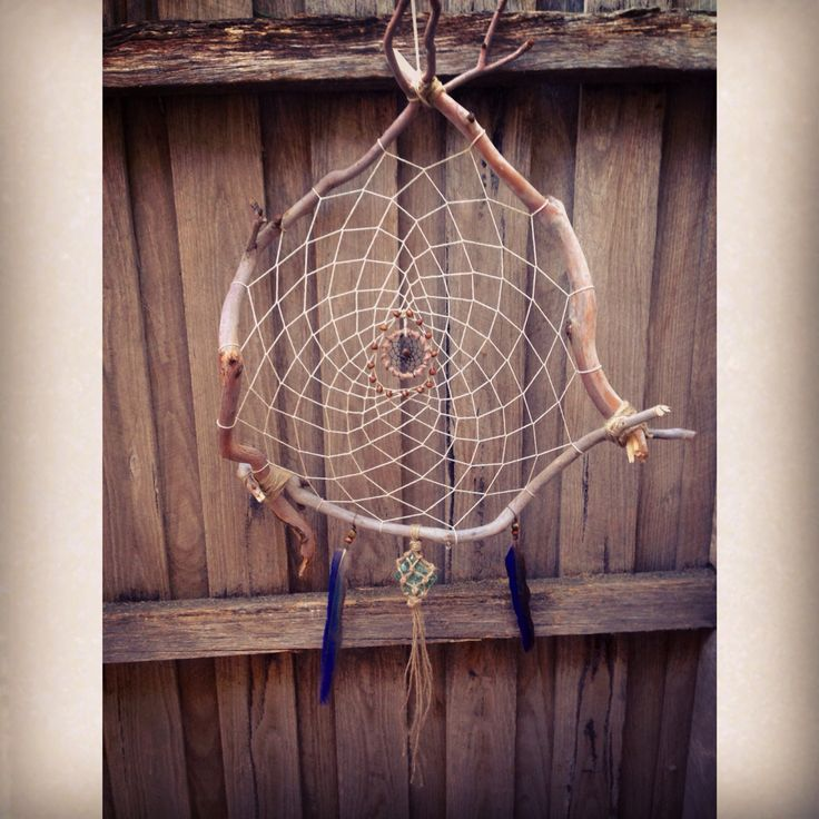 Wooden dreamcatcher with hemp cord, wood & tiger eye crystal beads, rosella feathers, a hanging raw green aventurine crystal and a miniature dreamcatcher for the centrepiece #dreamcatcher #hempcord #crystal #aventurine #feathers #macrame