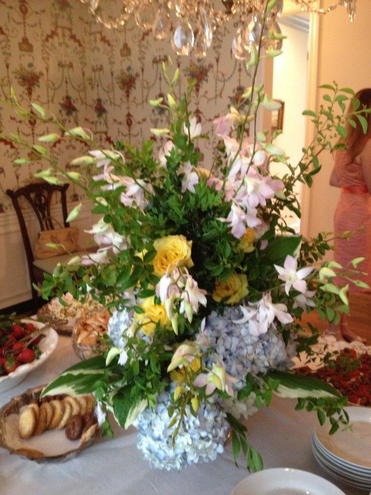 Dining room table arrangement of blue hydrangea yellow