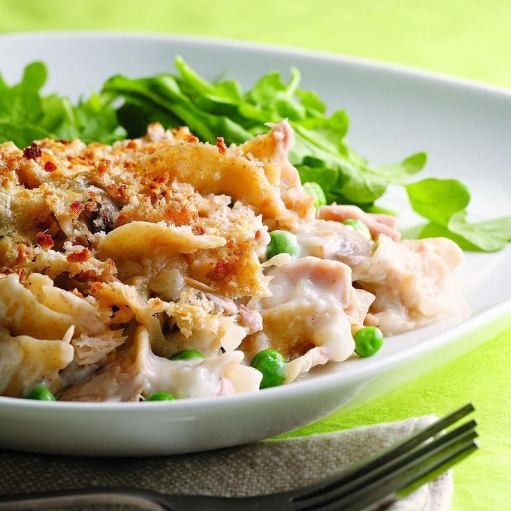 Known as Tuna-Pea Wiggle to some, this family-friendly tuna noodle casserole tends to be made with canned soup and whole milk, which means high fat and sodium. We remedy this by making our own creamy mushroom sauce with nonfat milk thickened with a bit of flour. Look for whole-wheat egg noodles--they have more fiber than regular egg noodles (but this dish will work well and taste great with either).