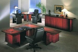 The photo shows the following models in rosewood: 6501/6506/6013 desk w/return 6020/6021/6515 wall unit 6590/6591 writing set 9688W executive chair w/leather black 9691 conference chair w/leather black 6518/4 conference table