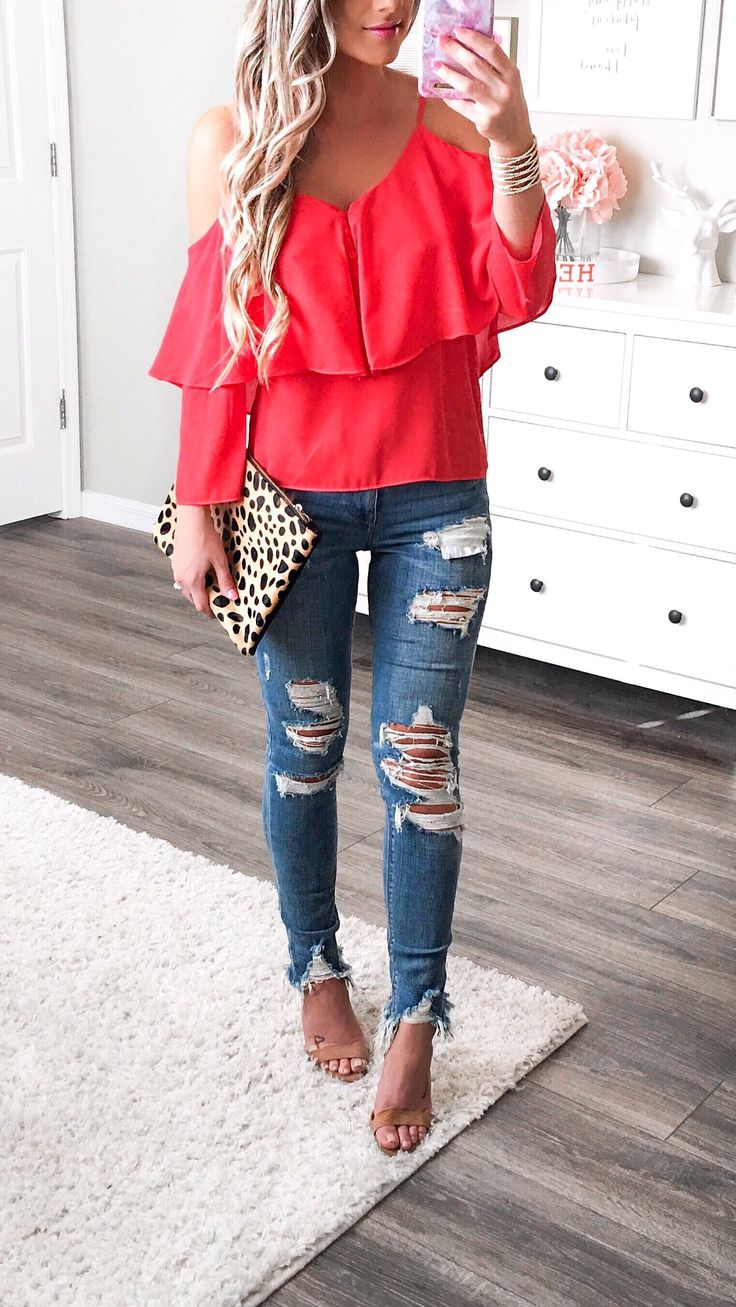 Red flowy cold shoulder top, ripped denim jeans and cheetah print clutch.