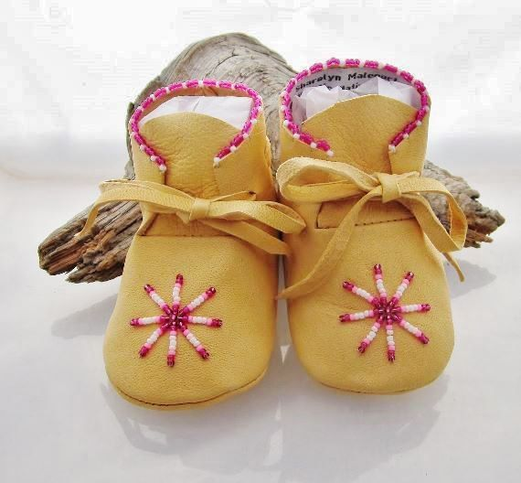 Baby Girl Shoes / Moccasins with Pink Beads in a star pattern.  The material is an incredibly soft supple deer hide that will stretch to fit your babys foot as he/she grows...deerskin is more breathable than cow-hide and vinyl for the ultimate in comfort. The seams are machine sewn for strength and durability, then trimmed and flatten to avoid irritation and rubbing. Soft soled shoes and boots are ideal for babies that are learning to walk, they are able to balance better because th...