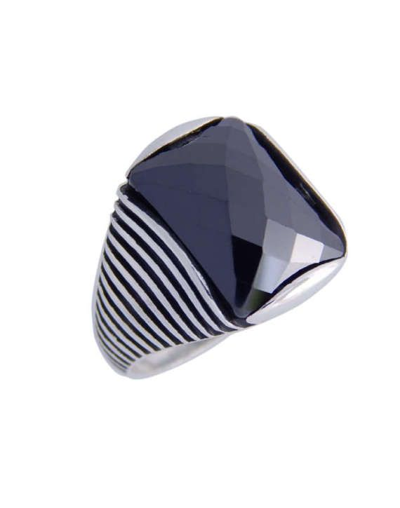 Man ring with faceted zirconia