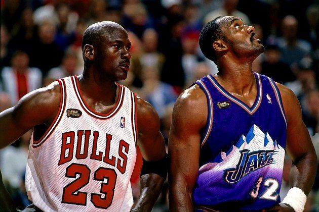 Michael Jordan and Karl Malone avoid eye contact in the 1998 NBA Finals (Andrew D. Bernstein/ Getty).