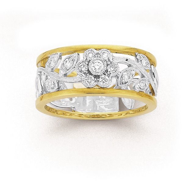 This Two Tone Floral Diamond Ring is the perfect addition to your outfit this Spring.