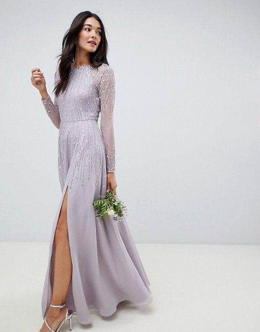8156ff3ee52b1 A stunning sequin lilac embellished bridesmaid dress featuring long semi  sheer sleeves and a front split.
