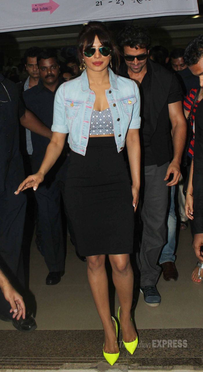 Priyanka Chopra looked chic and fun in a cropped top paired with a denim shrug, pencil skirt and bright neon pumps. We love! Hrithik Roshan seen along. #Bollywood #Fashion #Style #Beauty