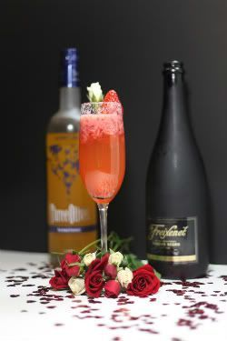 Strawberry Champagne Cocktail, Valentine's day cocktail with muddled strawberries, vodka, and champagne