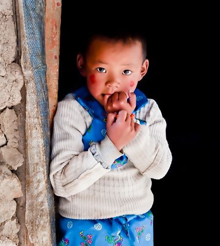 Child Monk living in the 'Gompas', Buddh Photo by Nora de Angelli - www.noraphotos.com -- National Geographic Your Shot