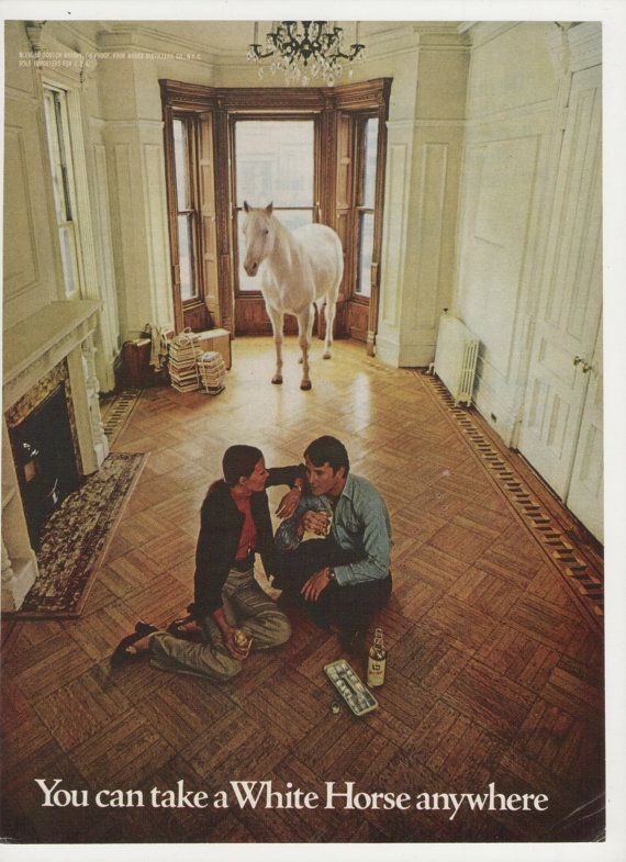"1972 White Horse Scotch Whiskey ad -- and source of the expression ""the white horse in the room."""