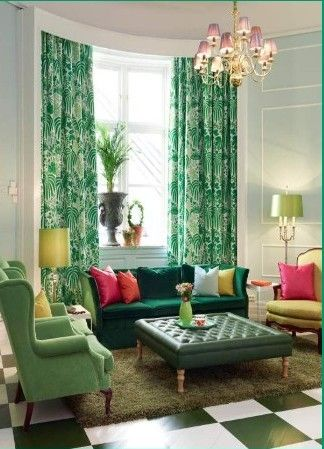 Even thought there are a lot of colors in this living room, it pulls together nicely with green being the focus.