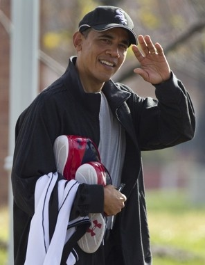 President Barack Obama waves as he leaves the Fort McNair athletic facility in Washington on Nov. 26, 2011, after playing basketball.
