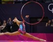 Uzbekistan's Ulyana Trofimova competes using the hoop in her individual all-around gymnastics qualification match during the London 2012 Olympic Games