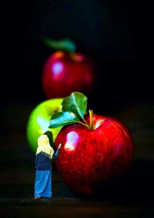 Mini people and an apple