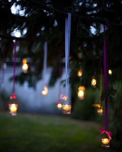 After the sun sets, keep the party alive by hanging votive candles with grosgrain ribbon. I love this idea Gela and the guest book idea they have also.