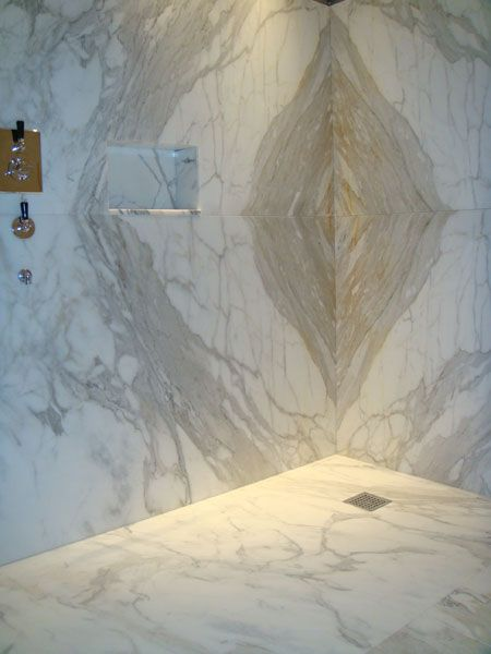 Sandstone Steam Room & Shower. Love it.  Love how the pattern turns the corner showing consecutive slabs.