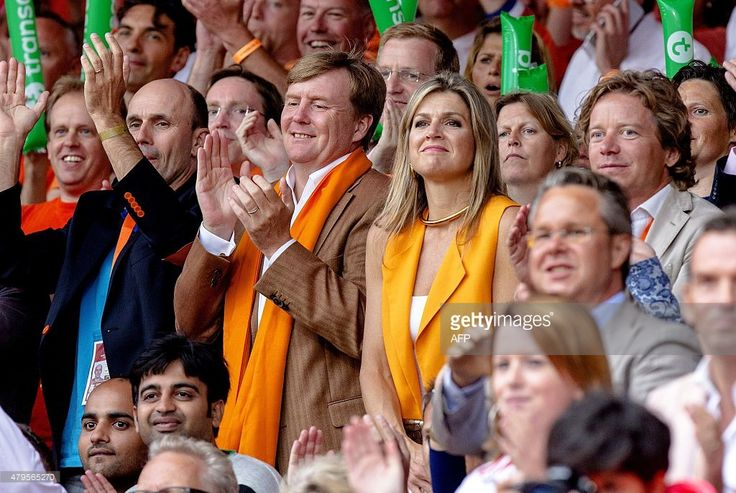 Dutch King Willem-Alexander and Queen Maxima attend the men's final match of the FIVB Beach Volleyball World Championships 2015 between the Netherland's Reinder Nummerdor and Christiaan Varenhorst and Brazil's Alison Cerutti and Bruno Schmidt in The Hague on July 5, 2015. AFP PHOTO / ANP / SANDER KONING        (Photo credit should read Sander KONING/AFP/Getty Images)