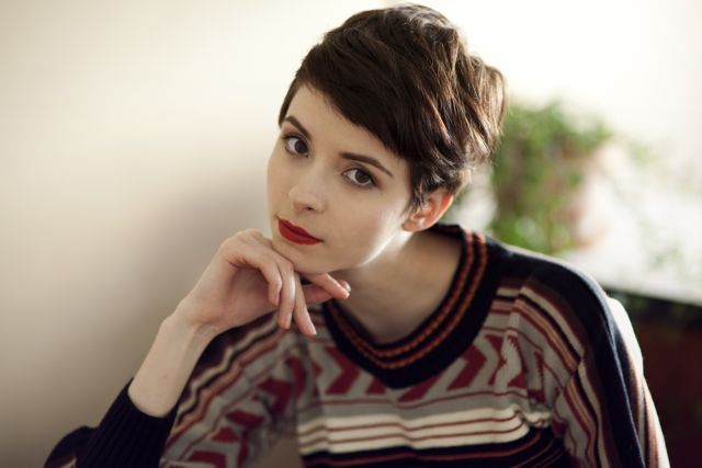 Brunette pixie, red lips, sweater