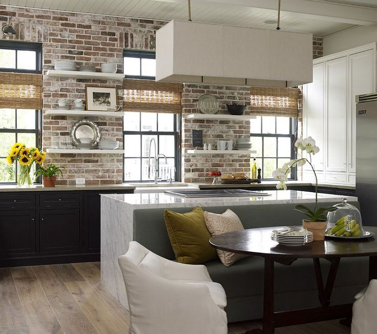 Concrete, Carrera marble and brick come together in the beautiful kitchen | www.homeology.co.za