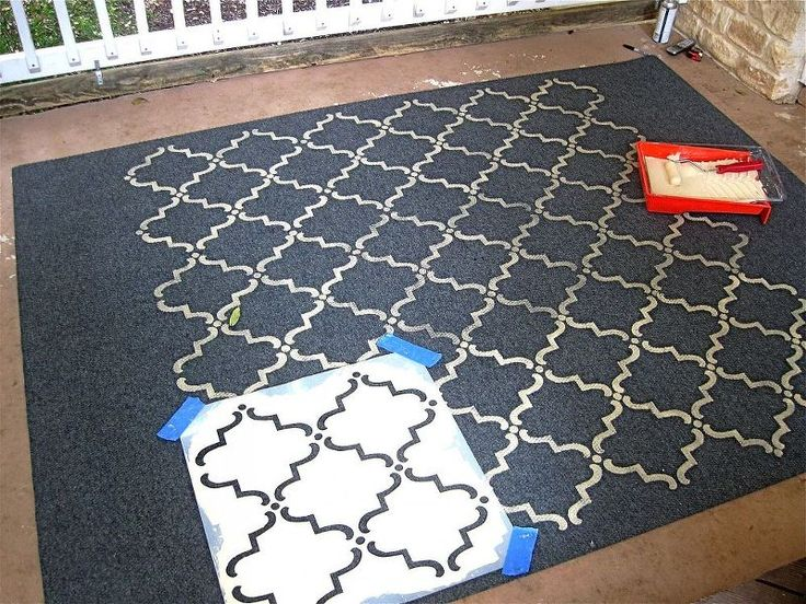 stenciled rug, flooring, home decor, outdoor living, painting, I needed to apply a little pressure for the design to be more intense
