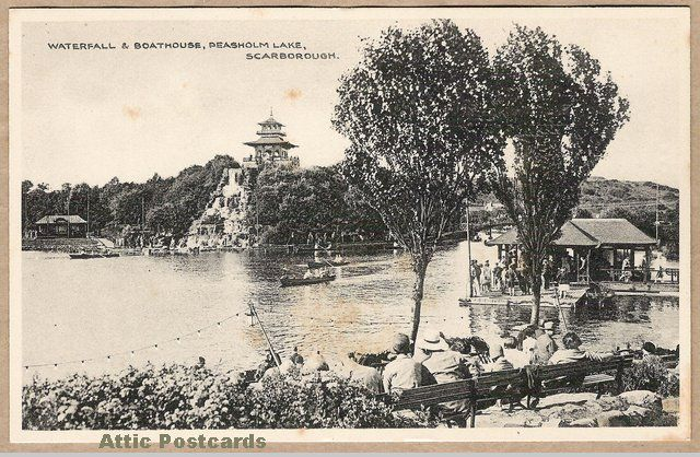 Vintage postcard of Peasholm Lake at Scarborough in Yorkshire, England.  Depicts a boathouse, waterfall, people and rowing boats.