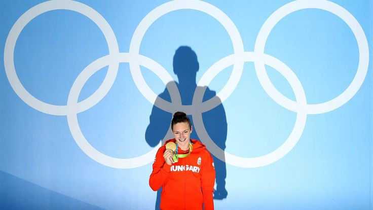 WR: Katinka Hosszu of Hungary shows off her gold medal after setting a world record in the final of the women's 400m individual medley, at the Olympic Aquatics Stadium