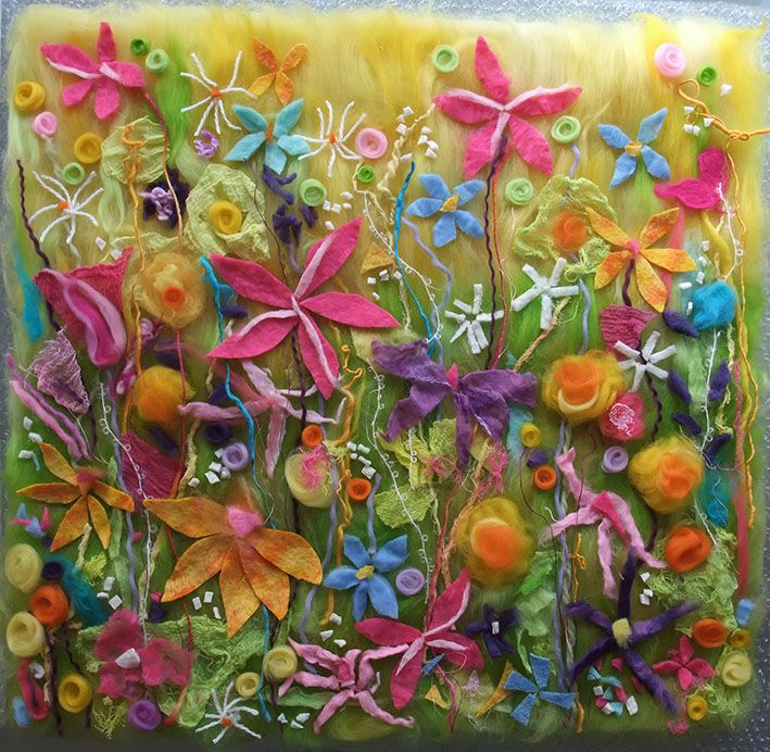 Felt spring flowers picture in progress before being wet felted