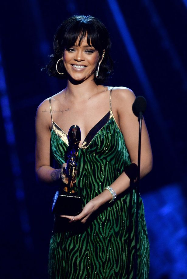 Recording artist Rihanna accepts the Billboard Chart Achievement Award onstage during the 2016 Billboard Music Awards