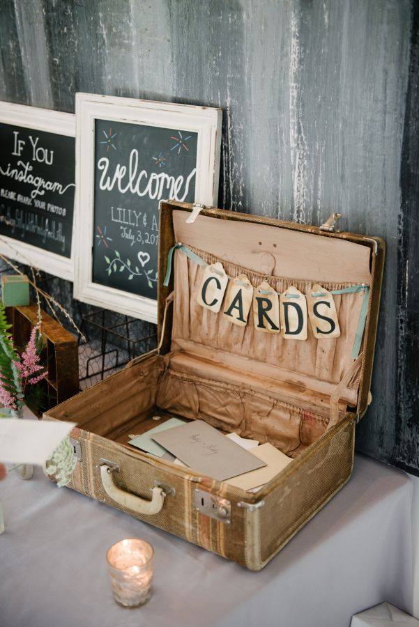 Rustic suitcase card display: http://www.stylemepretty.com/new-york-weddings/hudson-valley/2017/01/19/mixing-romance-and-greenery-with-a-stunning-rustic-backdrop/ Photography: Brian Hatton - http://brianhattonweddings.com/