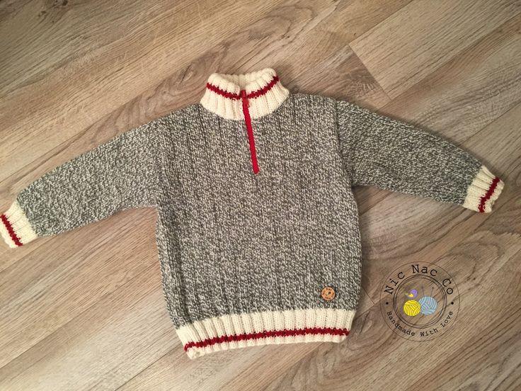 """Gilet très tendance, de style """"bas de laine"""" avec fermoir rouge et col montant…"""