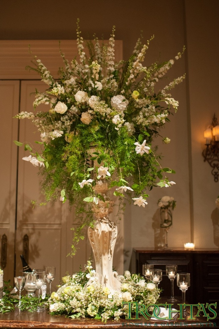 Decorate The Stage Area With Two Tall Floral Arrangements