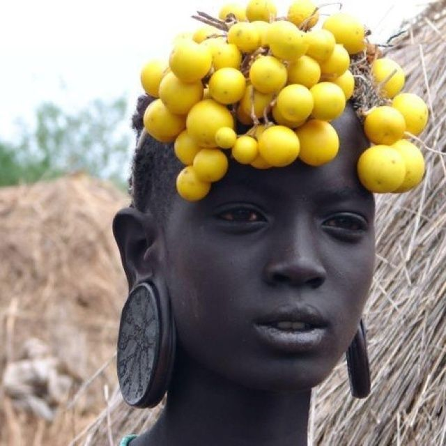 African woman. [perhaps a Mursi from Omo valley, Ethiopia ?]: