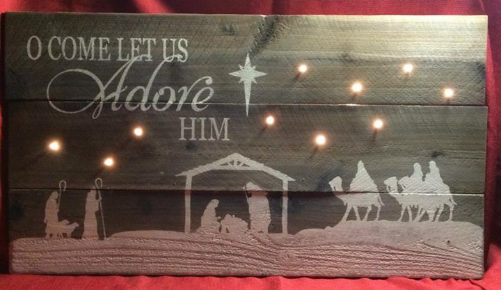 "Oh Come Let Us Adore Him, illuminated, distressed picket sign with a ""starry night"". 10 clear Christmas lights attached on the back of sign (plug in or battery both available). Approximate size 30"" x 16.5""  $43.00  https://www.facebook.com/SurfTheSnake/photos/pb.101770623301816.-2207520000.1412133615./553148168164057/?type=3&theater"