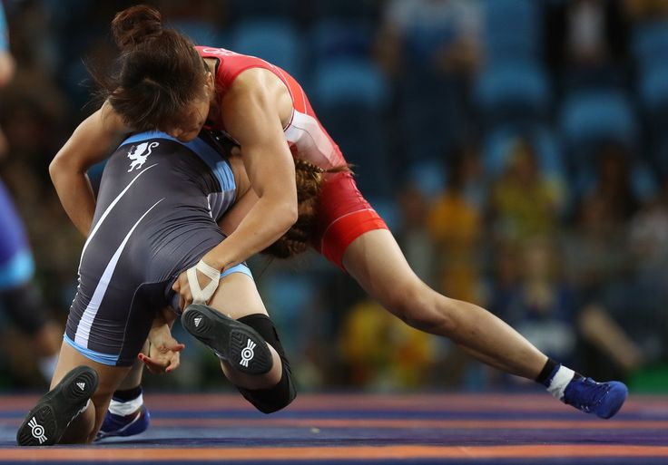 Kaori Icho (R) of Japan competes against Marwa Amri of Tunisia during a Women's Freestyle 58kg 1/8 Final bout on Day 12 of the Rio 2016 Olympic Games at Caioca Arena 2 on August 17, 2016 in Rio de Janeiro, Brazil.