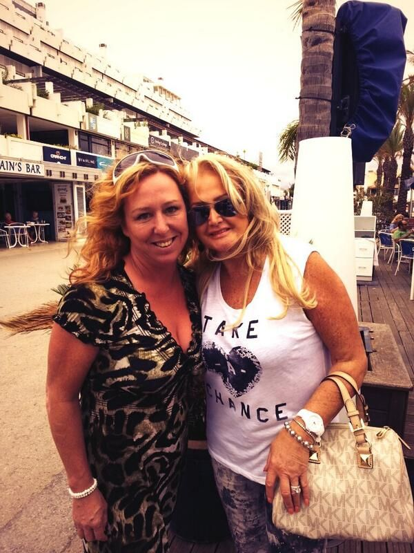 """On October 2, 2013, Bonnie Tyler was in Portugal in the Algarves in Vilamoura. She had her beautiful bag by Michael Kors and a lovely top where it is written """"TAKE A CHANCE"""".  We can notice it is still summer in South Portugal with Bonnie's clothes! We understand why she loves this place! The weather is much better than in South Wales. (Thank you so much to Patsy Mcmulle for sending to me picture!)"""