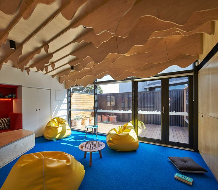 Children's space in the Cubbyhouse at Broadmeadows Children's Court with yellow bean bags and plywood fins suspended above | Cubbyhouse by Mihaly Slocombe (2014-15) | Broadmeadows, Victoria, Australia | Photo: Peter Bennetts