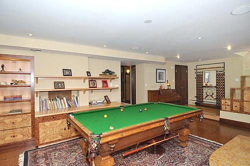Recreation room with custom exotic wood built-ins