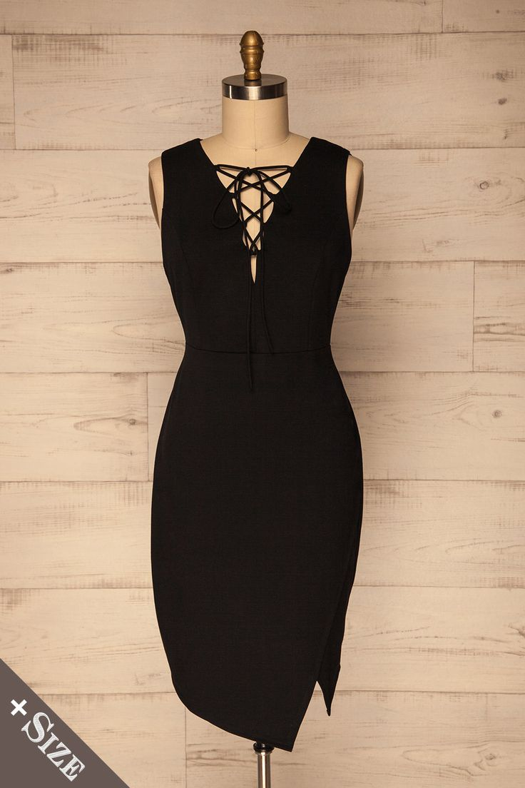 Aberg #boutique1861 / Your inner rockstar will not be able to resist this black cocktail dress! The laces up the neckline and subtle overlapping detail on the bottom of the skirt give it a modern style, adding to its glamour. The fitted cut falls to your knees, hugging your curves to accentuate your silhouette.