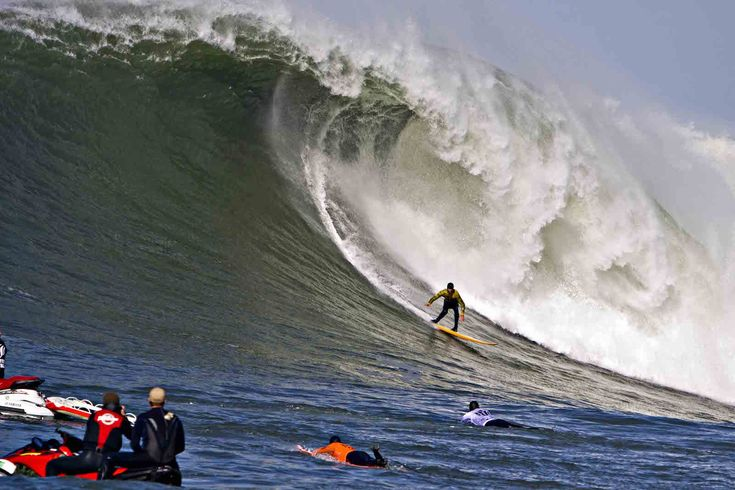 At Pillar Point Harbor off California's Half Moon Bay coast side, 2 dozen big-wave surfers participate in the annual Mavericks Surf Competition.